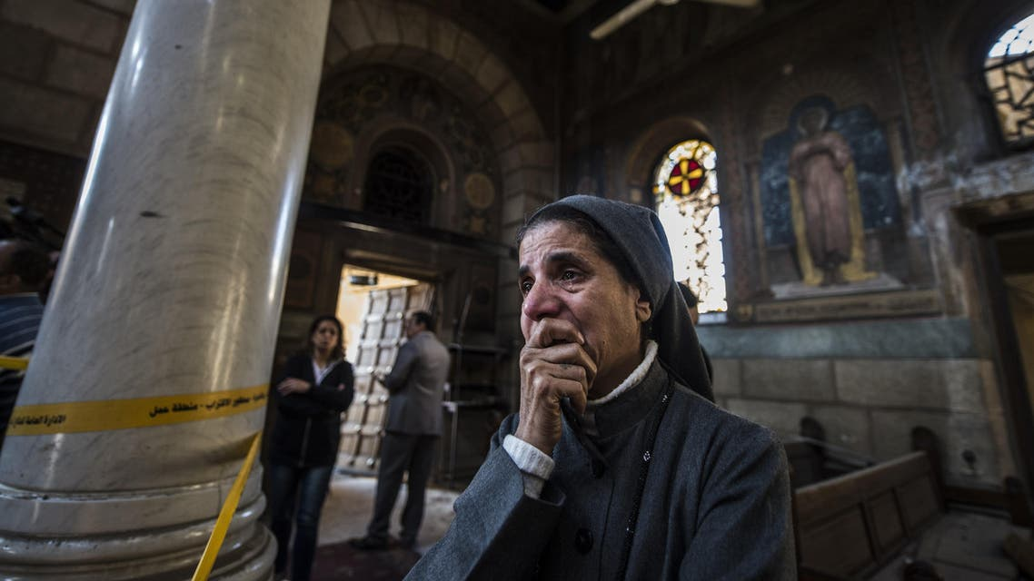A nun reacts as Egyptian security forces (unseen) inspect the scene of a bomb explosion at the Saint Peter and Saint Paul Coptic Orthodox Church on December 11, 2016, in Cairo's Abbasiya neighbourhood. The blast killed at least 25 worshippers during Sunday mass inside the Cairo church near the seat of the Coptic pope who heads Egypt's Christian minority, state media said. KHALED DESOUKI / AFP