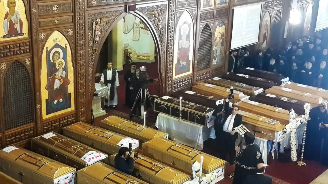 Egyptian clergymen stand next to the coffins of the victims of a bomb explosion that targeted a Coptic Orthodox Church the previous day in Cairo, during their funeral in the Egyptian capital's Nasr City neighbourhood on December 12, 2016. Khaled DESOUKI / AFP