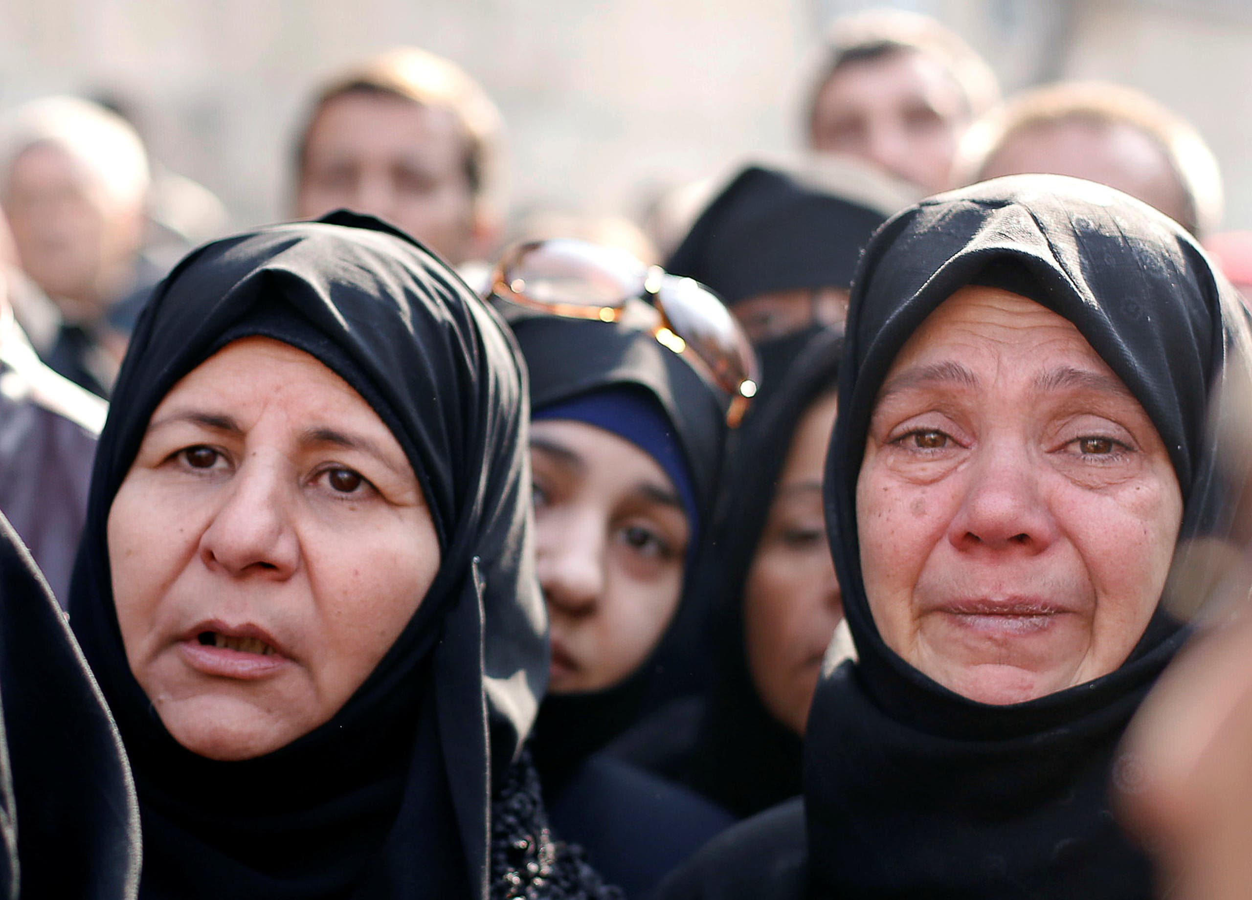 Women react as they wait outside a government military police centre to visit their relatives, who were evacuated from the eastern districts of Aleppo and are being prepared to begin their military service, in Aleppo, Syria December 11, 2016. REUTERS/Omar Sanadiki