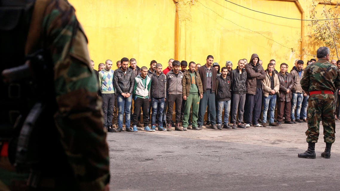 Members of government military police stand guard as men, who were evacuated from the eastern districts of Aleppo, are being prepared to begin their military service at a police centre in Aleppo, Syria December 11, 2016. REUTERS/Omar Sanadiki Download Picture Share via Email      Date11/12/2016 17:37     Dimensions3500 x 2333     Size1.7MB     Edit Statusnew     CategoryI     Supplemental CategoryCWP DEF EUROP MEAST PIA PL POL SY VIO WAR     Fixture IdentifierRC1CAFC65EB0     BylineOMAR SANADIKI     CityALEPPO     Country NameSYRIA     Country CodeSYR     OTRSYR10     CreditREUTERS     SourceX03682     Caption WriterCK//JG     Source News FeedsUAE Picture Service     IDtag:reuters.com,2016:newsml_RC1CAFC65EB0:1880457365