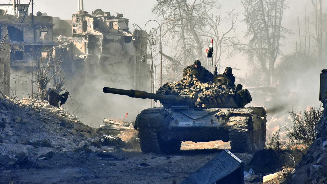Syrian pro-government forces manoeuver a tank in the newly retaken area of Sahat al-Melh and Qasr al-Adly in Aleppo's Old City on December 8, 2016. (AFP)