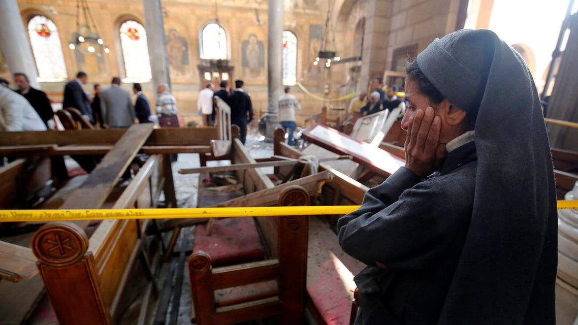 A nun cries as she stands at the scene inside Cairo's Coptic cathedral, following a bombing, in Egypt December 11, 2016. (Reuters)