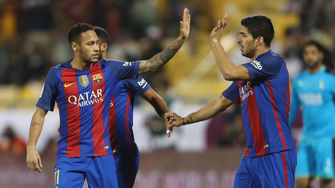 FC Barcelona's Luis Suarez (R) and Neymar celebrate after a goal during a friendly football match between FC Barcelona and Saudi Arabia's Al-Ahli FC on December 13, 2016 in the Qatari capital Doha. (AFP)