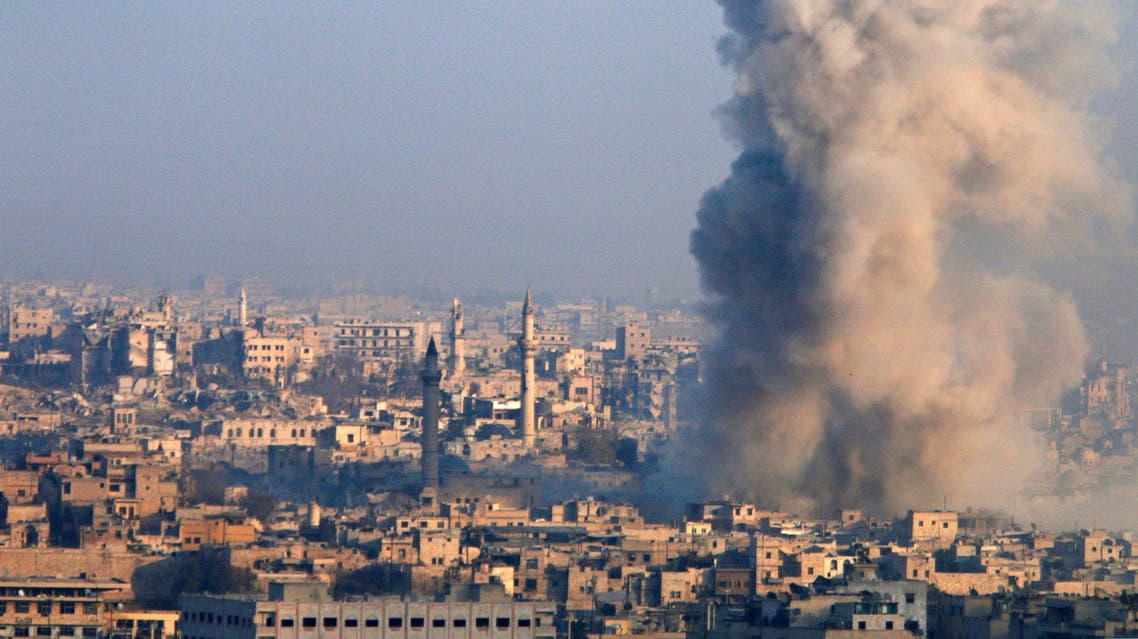 2 Smoke rises as seen from a rebel-held area of Aleppo, Syria December 12, 2016