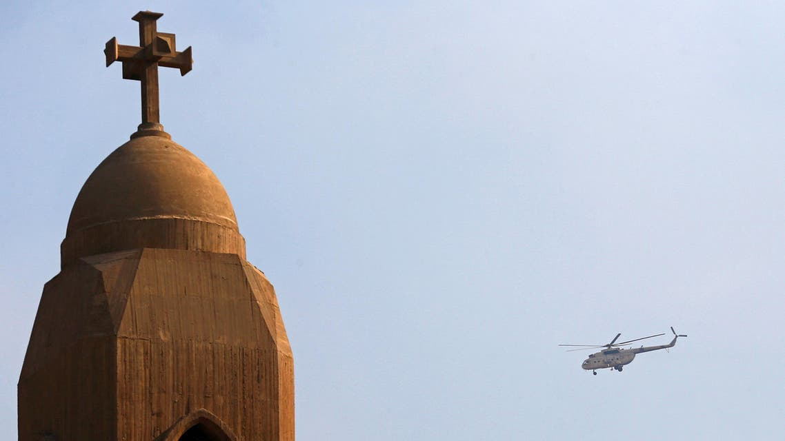 A military helicopter flies above the Virgin Mary church during the funeral for victims killed in the bombing of Cairo's main Coptic cathedral, in Cairo, Egypt December 12, 2016. (Reuters