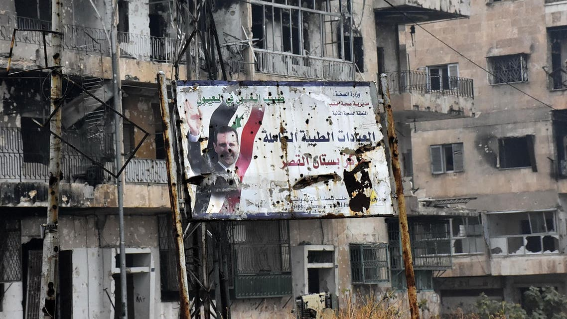 A general view shows a poster of Syria's President Bashar al-Assad in Aleppo's Bustan al-Qasr neighbourhood after Syrian pro-government forces captured the area in the eastern part of the war torn city on December 13, 2016. After weeks of heavy fighting, regime forces were poised to take full control of Aleppo, dealing the biggest blow to Syria's rebellion in more than five years of civil war.  George OURFALIAN / AFP