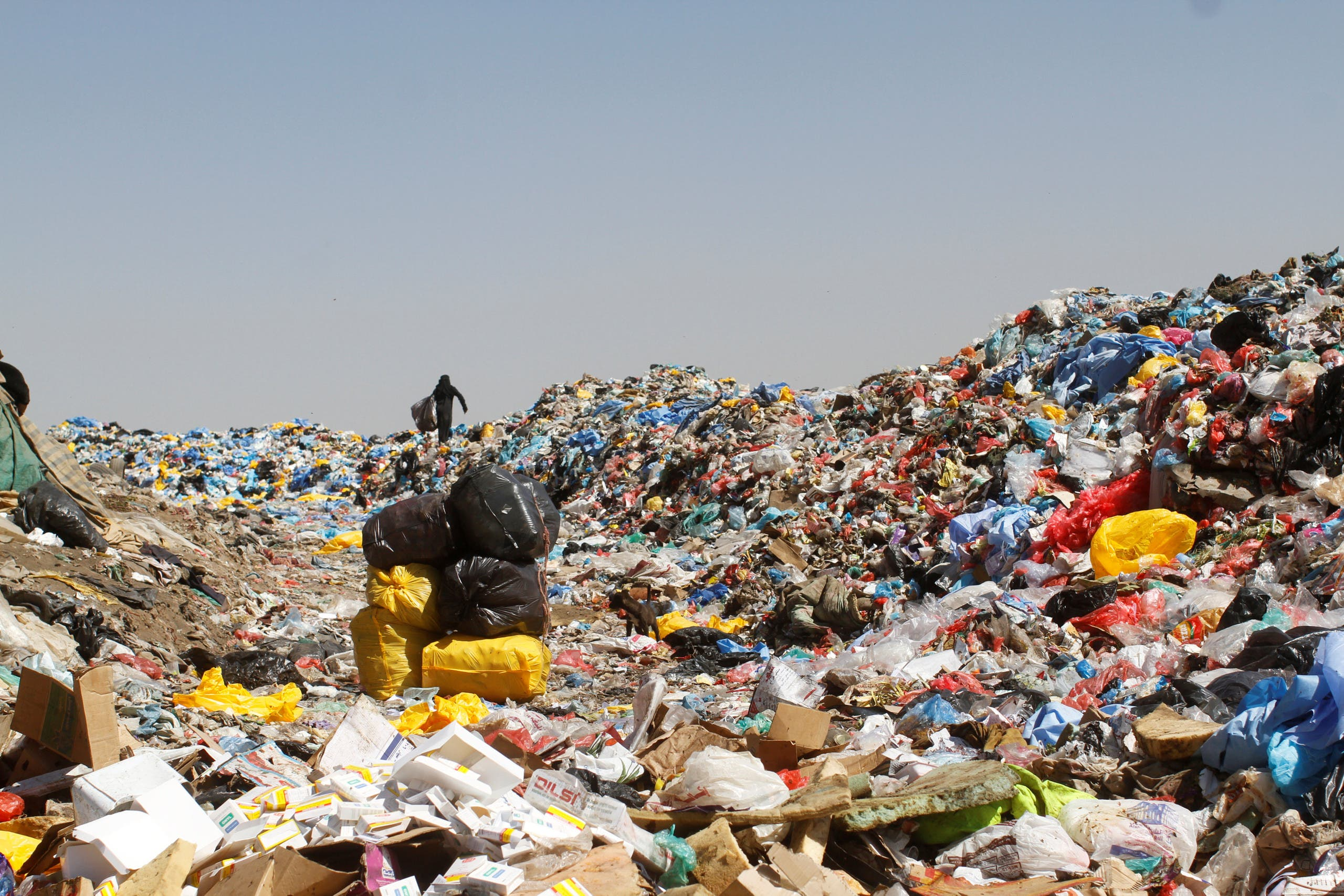 A woman carries a bag of recyclable items she collected at a rubbish dump site on the outskirts of Sanaa, Yemen November 16, 2016. reuters