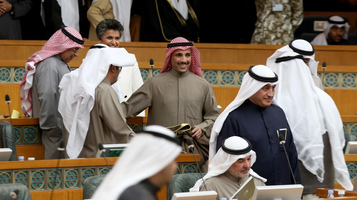 """Kuwaiti parliament speaker Marzouq al-Ghanim (C) is congratulated by MPs after his election during the opening session of the new parliament in Kuwait City, on December 11, 2016. Kuwait's Emir Sheikh Sabah al-Ahmad Al-Sabah opened the new parliament by declaring that a reduction in public spending is """"inevitable"""" in the face of weak oil prices. Yasser Al-Zayyat / AFP"""