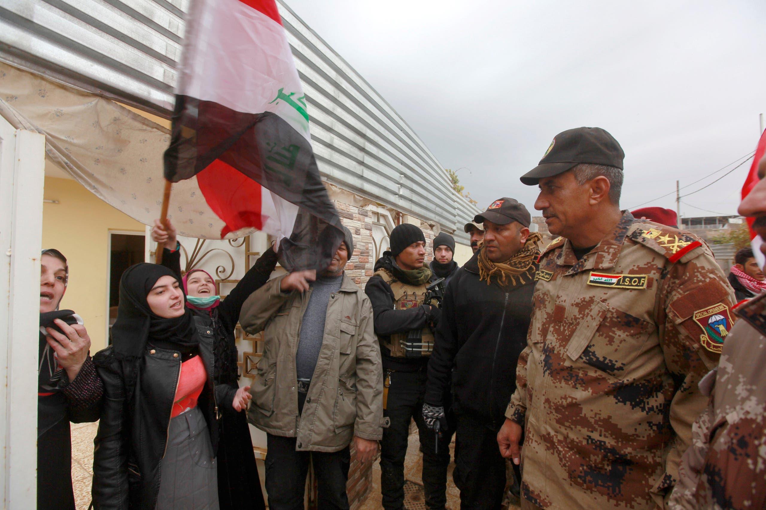 Lieutenant General Abdel Wahab al-Saadi (R) greets people as they celebrate in Qadisiyah neighborhood north of Mosul, Iraq, December 14, 2016. REUTERS/Alaa Al-Marjani