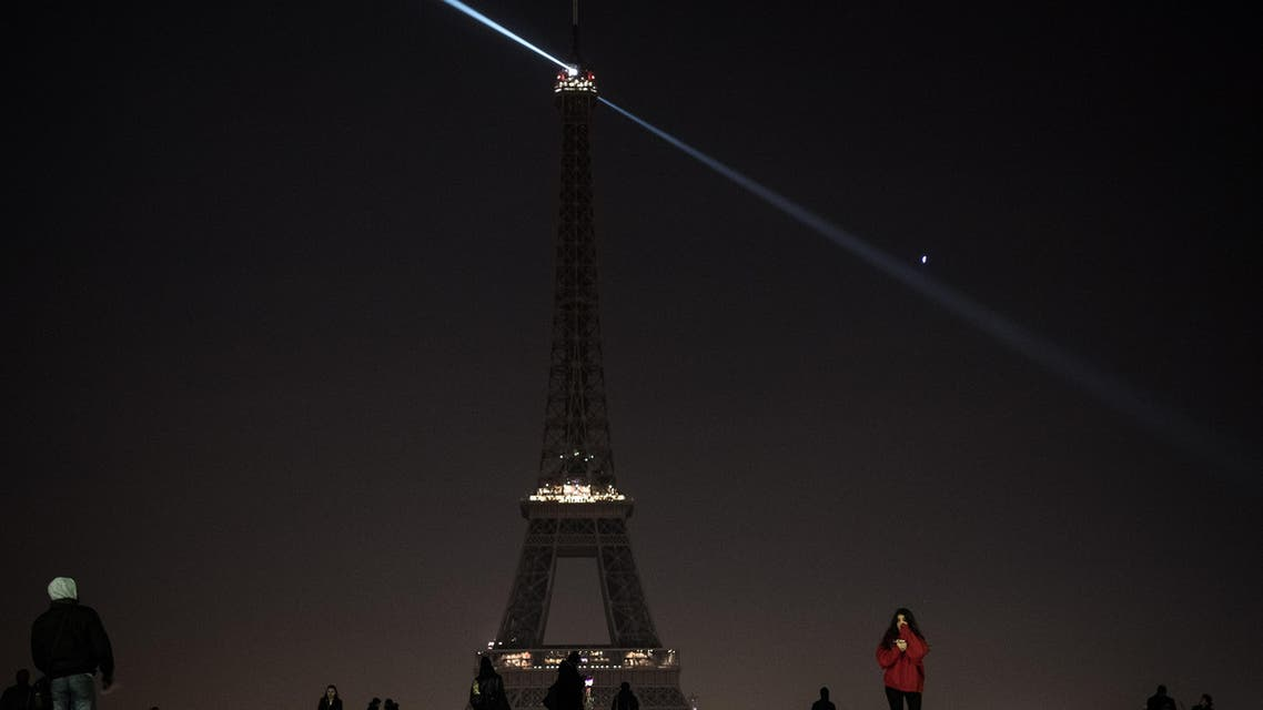 The lights of the Eiffel Tower are exceptionally switched off in Paris, on December 14, 2016, in support of the Syrian city of Aleppo. Shelling and air strikes sent terrified residents running through the streets of Aleppo on December 14, 2016 as diplomats strove to save a deal to evacuate the shrinking rebel-held districts of the city.  PHILIPPE LOPEZ / AFP