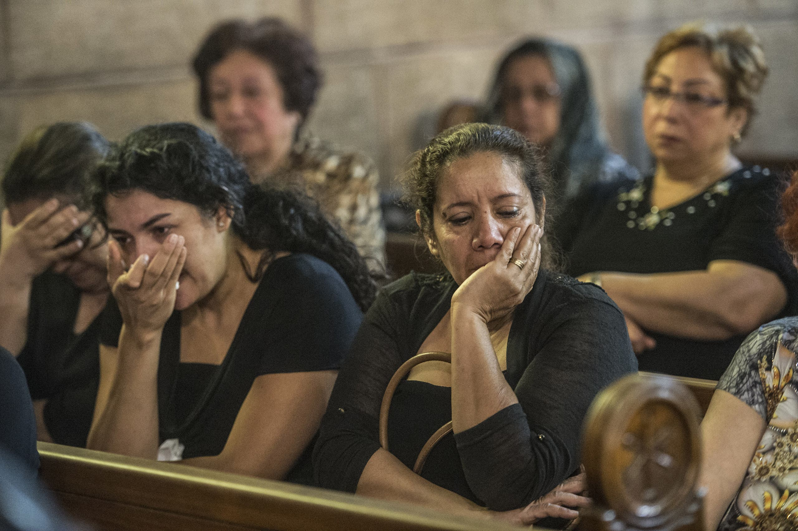 Relatives and friends of the cabin crew and passengers, who were on board the EgyptAir plane that crashed in the Mediterranean, attend a mourning ceremony on May 22, 2016 at the Saint Peter and Saint Paul Coptic Orthodox Church in Cairo's Abbasiya district. (AFP)