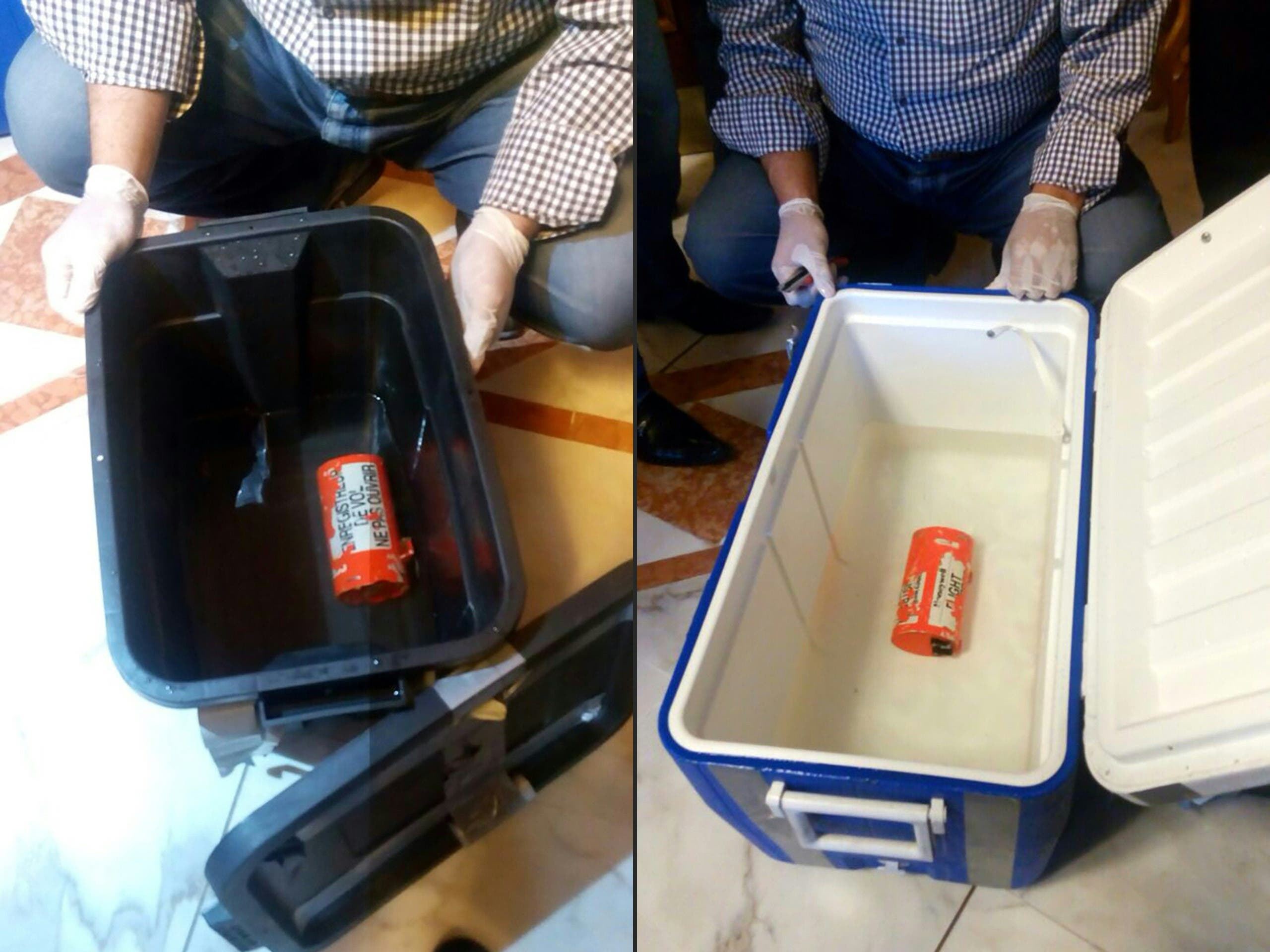 This combination of pictures created on June 17, 2016 shows a handout picture taken at an undisclosed location in Egypt and released by the Egyptian Media Center of the ministry of Civil Aviation on June 17, 2016 showing the flight recorder (L) from the EgyptAir plane, that crashed into the Mediterranean last month, after it was recovered from the bottom of the Mediterranean by search teams. (AFP)