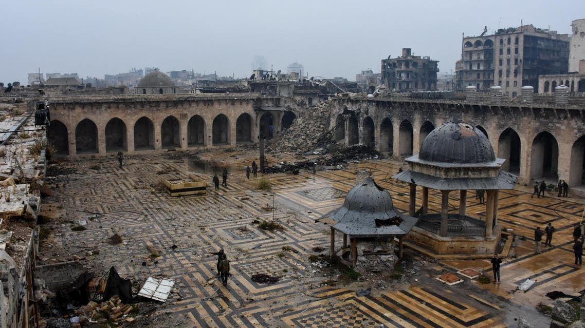 A general view shows Syrian pro-government forces walking in the ancient Umayyad mosque in the old city of Aleppo on December 13, 2016, after they captured the area. After weeks of heavy fighting, regime forces were poised to take full control of Aleppo, dealing the biggest blow to Syria's rebellion in more than five years of civil war. afp