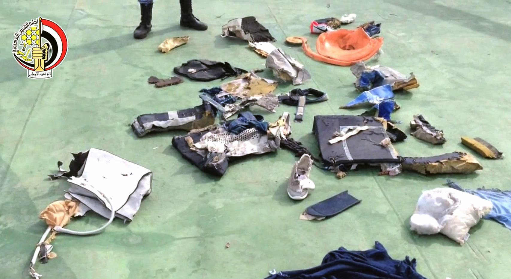 An image grab taken from a video uploaded on the official Facebook page of the Egyptian military spokesperson on May 21, 2016 and taken from an undisclosed location reportedly shows some debris that the search teams found in the sea after the EgyptAir Airbus A320 crashed in the Mediterranean. (AFP)