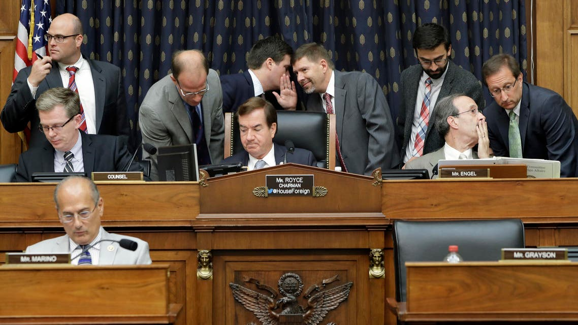 House Foreign Affairs Committee Chairman Rep. Ed Royce, R-Calif., center, and the committee's ranking member Rep. Eliot Engel, D-N.Y., second from right, listen to staffers as they confer on Capitol Hill in Washington, during the committee's hearing on Iran. (AFP)