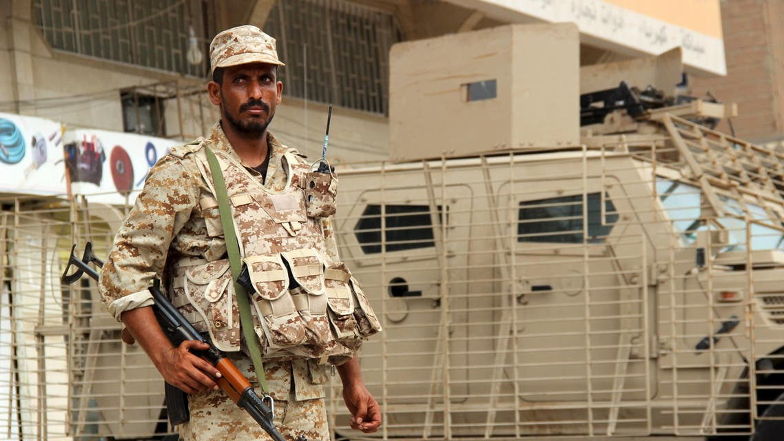 A Yemeni army soldier stands guard as he secures a street in Mansoura district of Yemen's southern port city of Aden March 30, 2016. The Yemeni army backed by local fighters seized control of parts of Aden held by al Qaeda on Wednesday as part of a push to clear the hardline group from its stronghold in the southern port city, a security official said. REUTERS