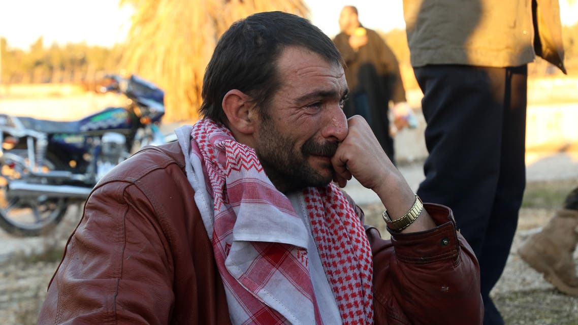 A Syrian man, who was evacuated from rebel-held neighbourhoods in the embattled city of Aleppo, cries upon his arrival in the opposition-controlled Khan al-Aassal region, west of the city, on December 15, 2016, the first stop on their trip, where humanitarian groups will transport the civilians to temporary camps on the outskirts of Idlib and the wounded to field hospitals. Hundreds of civilians and rebels left Aleppo under an evacuation deal that will allow Syria's regime to take full control of the city after years of fighting. Baraa Al-Halabi / AFP