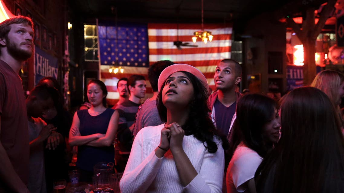 Sri Vasamsetti, 22, of Seattle and a supporter of Democratic presidential candidate Hillary Clinton, watches televised coverage of the US presidential election at the Comet Tavern in the Capitol Hill neighborhood of Seattle, Washington on November 8, 2016. (AFP)