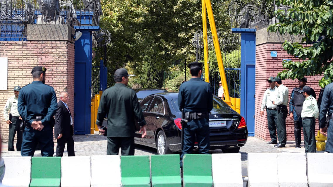 Iranian security forces stand guard as Britain's Foreign Secretary Philip Hammond arrives in his car at the British embassy on August 23, 2015 in the capital Tehran. AFP