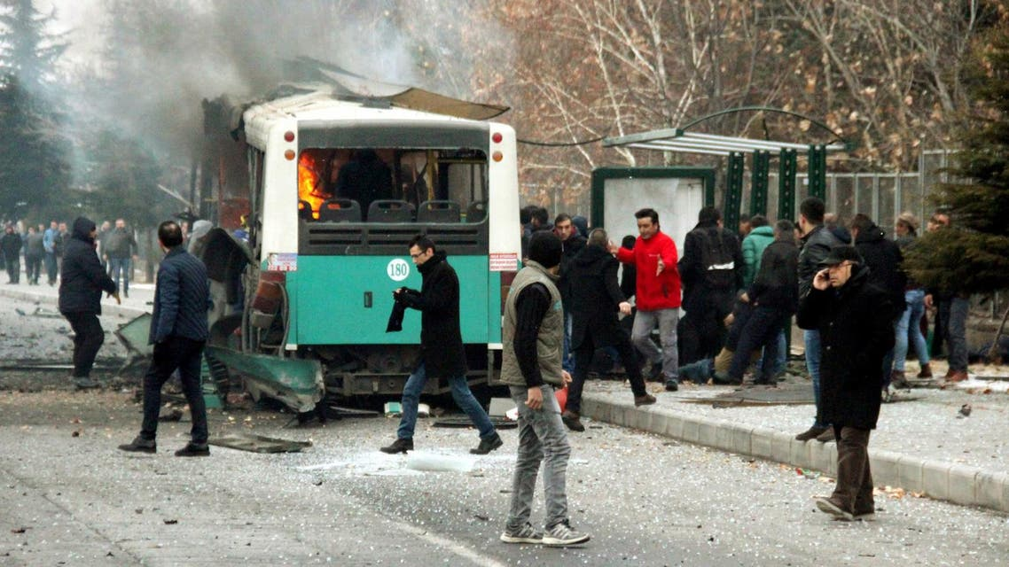 People react after a bus was hit by an explosion in Kayseri, Turkey, December 17, 2016. Turan Bulut/ Ihlas News Agency via REUTERS ATTENTION EDITORS - THIS PICTURE WAS PROVIDED BY A THIRD PARTY. FOR EDITORIAL USE ONLY. NO RESALES. NO ARCHIVE. TURKEY OUT. NO COMMERCIAL OR EDITORIAL SALES IN TURKEY. TPX IMAGES OF THE DAY