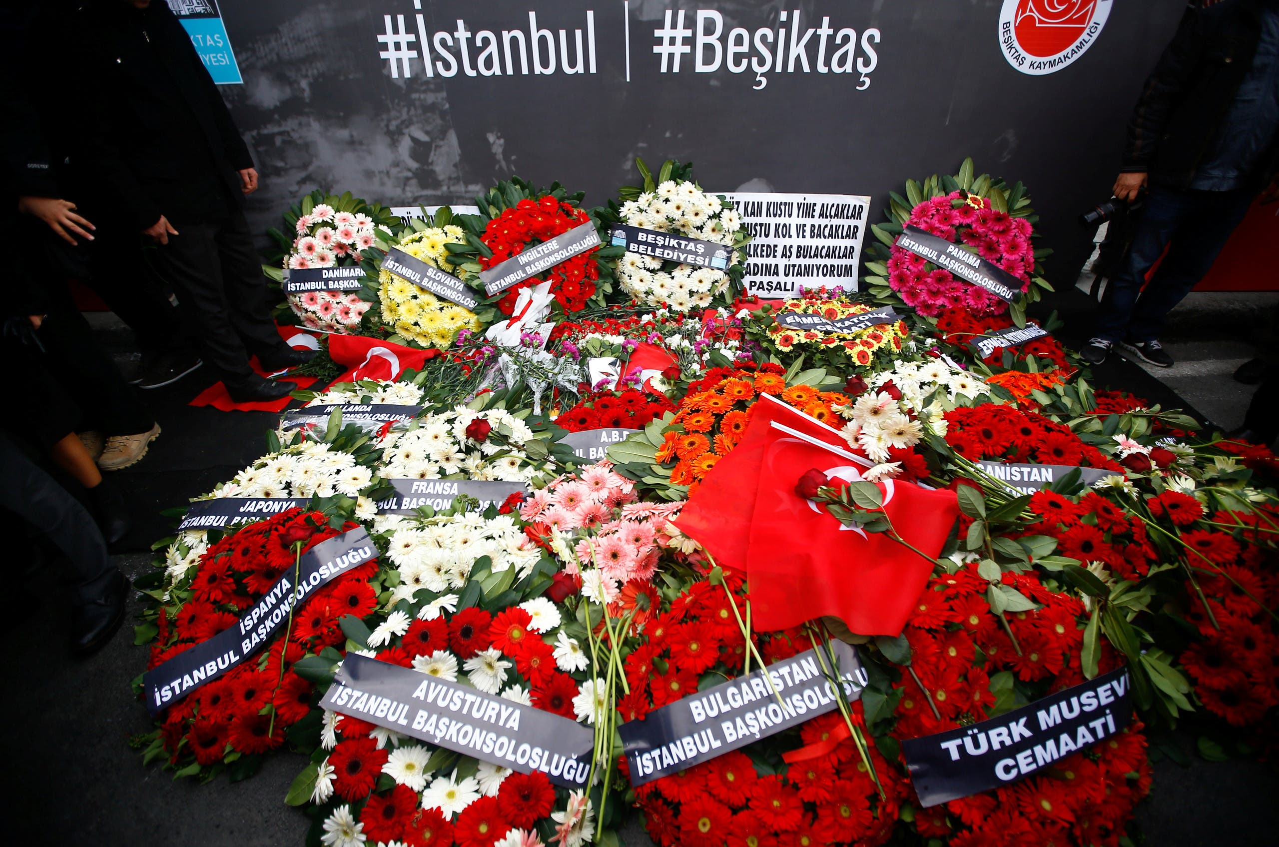 Wreaths, placed by representatives of foreign missions, are pictured at the scene of Saturday's blasts in Istanbul, Turkey, December 12, 2016. REUTERS/Osman Orsal