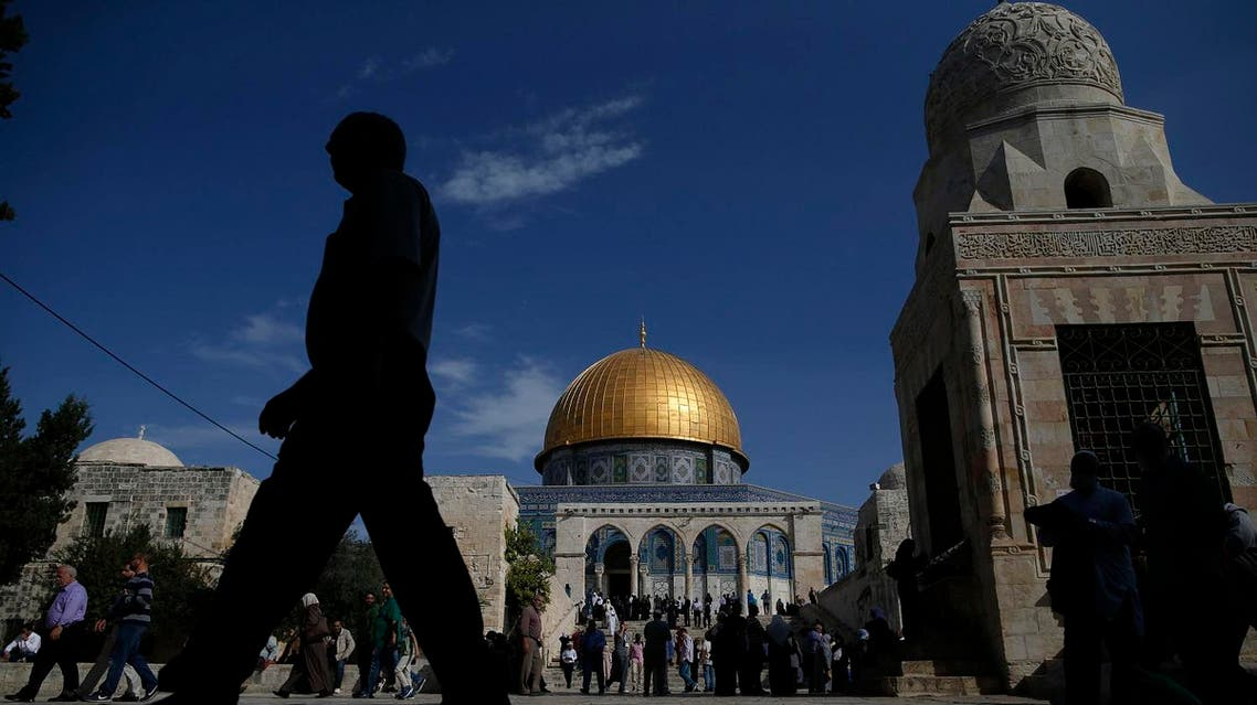 A Palestinian man walks past the Dome of Rock at the Al-Aqsa Mosque compound after the Friday prayer in Jerusalem's Old City on November 11, 2016. AHMAD GHARABLI / AFP