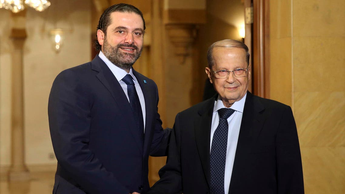 Former Lebanese Prime Minister Saad Hariri, left, shakes hands with Christian leader Michel Aoun, right, after Hariri announced his support for Aoun to be a Lebanese president, in Beirut, Lebanon, Thursday, Oct. 20, 2016. AP