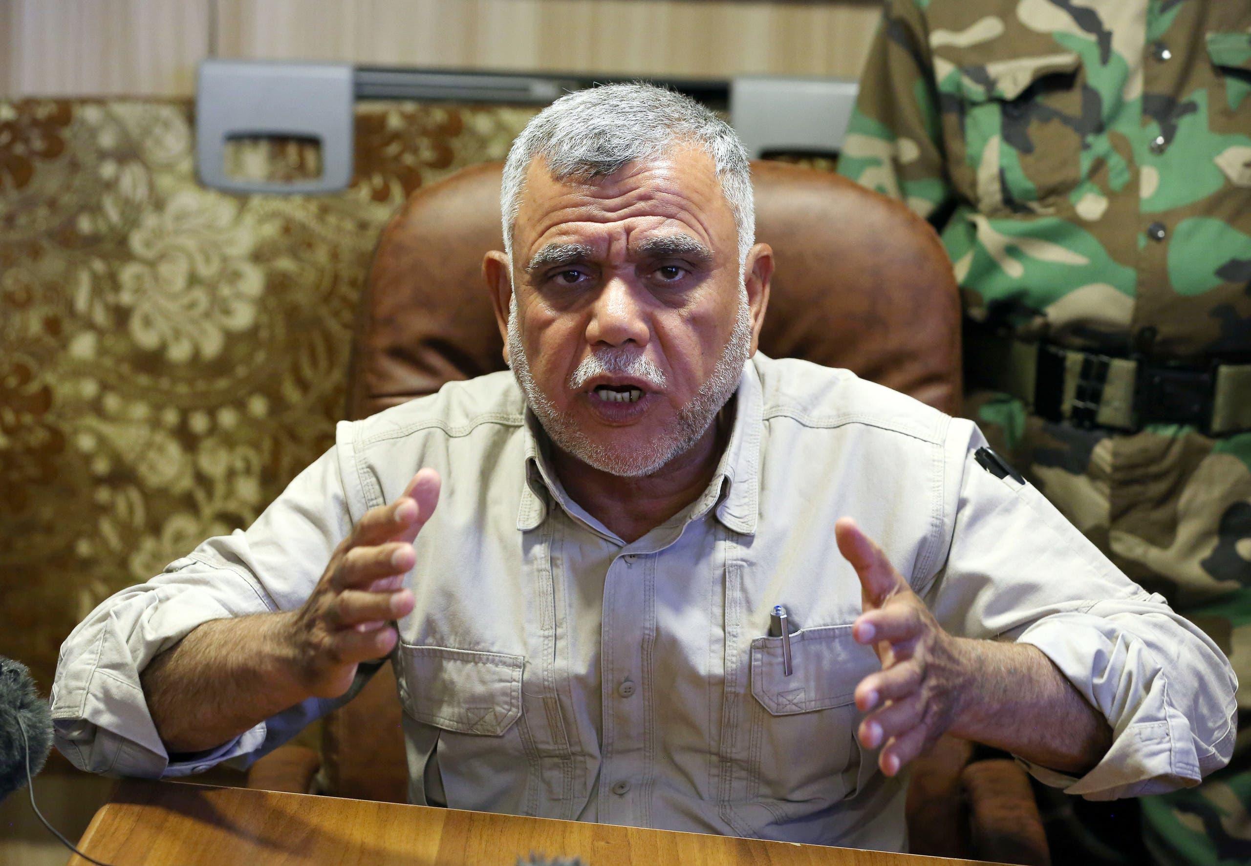 Popular Mobilization Forces commander Hadi al-Amiri speaks to journalists in Nbaie (20 kilometers) of Baghdad, Iraq, Friday, June 12, 2015. ap