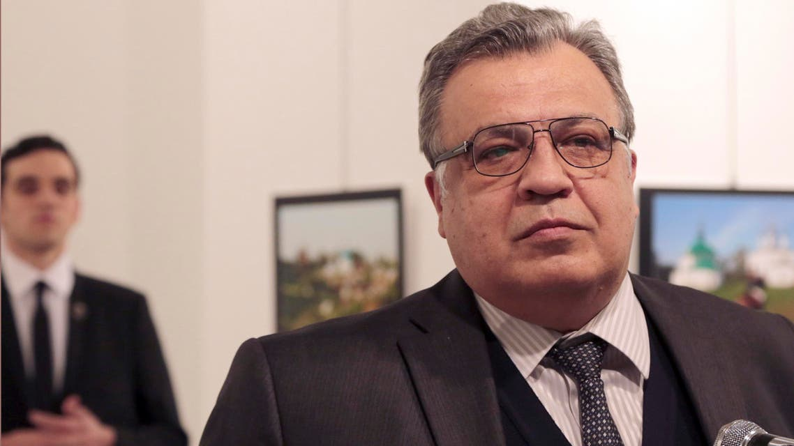 Andrei Karlov, the Russian Ambassador to Turkey, speaks at a photo exhibition in Ankara on Monday, Dec. 19, 2016, moments before a gunman opened fire on him. (AP)
