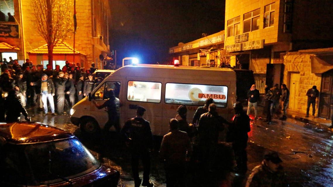 Jordanian policemen and an ambulance are seen in the vicinity of Karak Castle in the city of Karak, Jordan, December 18, 2016. (Reuters)