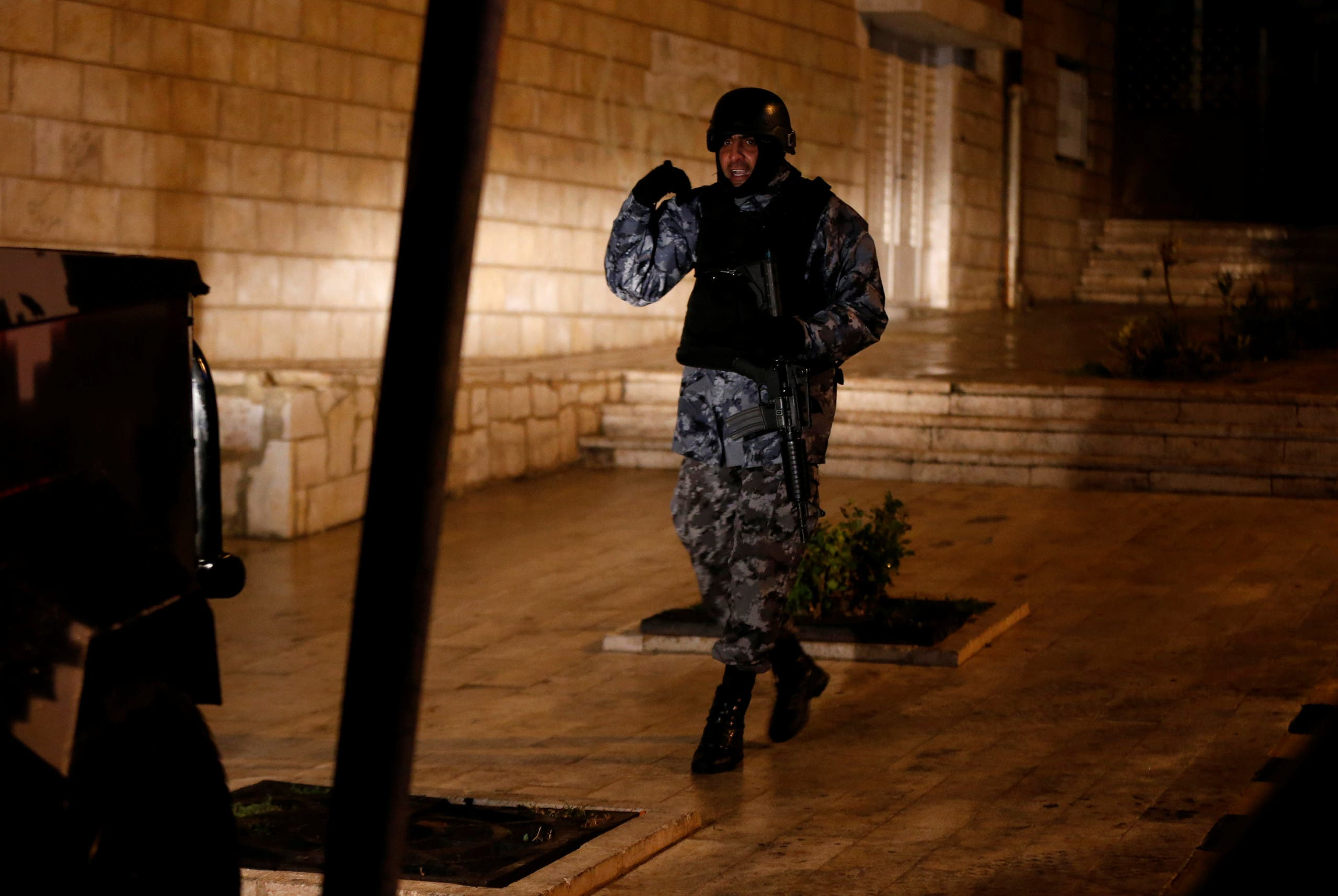 A Jordanian policeman stands guard in the vicinity of Kerak Castle where armed gunmen carried out an attack, in the city of Karak, Jordan, December 18, 2016. reuters