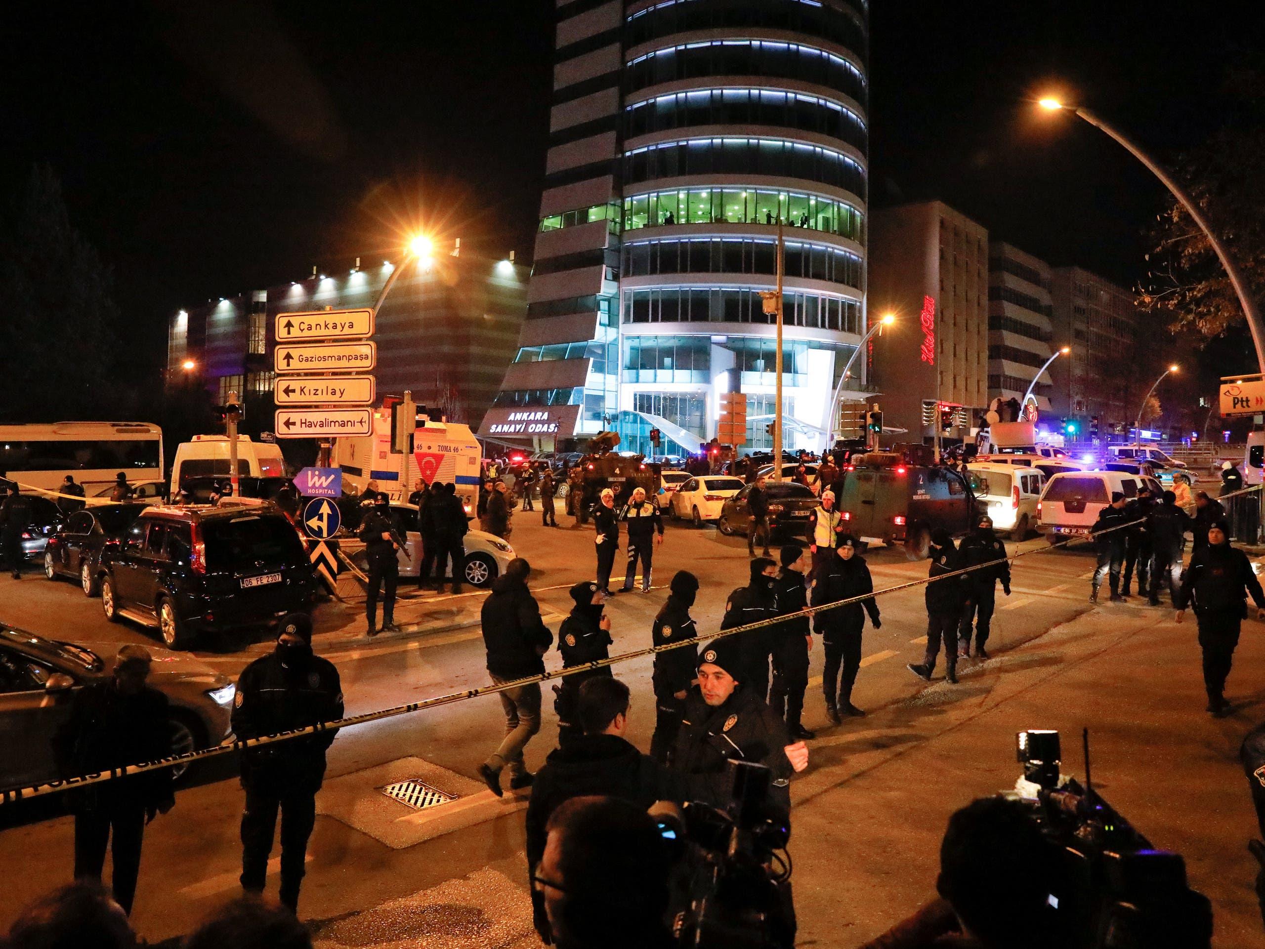 Turkish police secure the area near an art gallery where the Russian Ambassador to Turkey Andrei Karlov was shot in Ankara, Turkey, December 19, 2016.  AFP