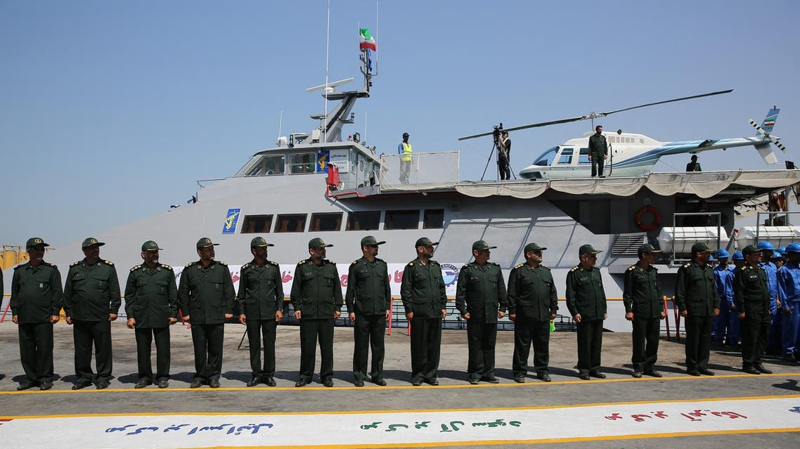 Members of Iran's Revolutionary Guard stand in front of a newly inaugurated high-speed catamaran, in the port city of Bushehr, northern Persian Gulf, Iran, Tuesday, Sept. 13, 2016.