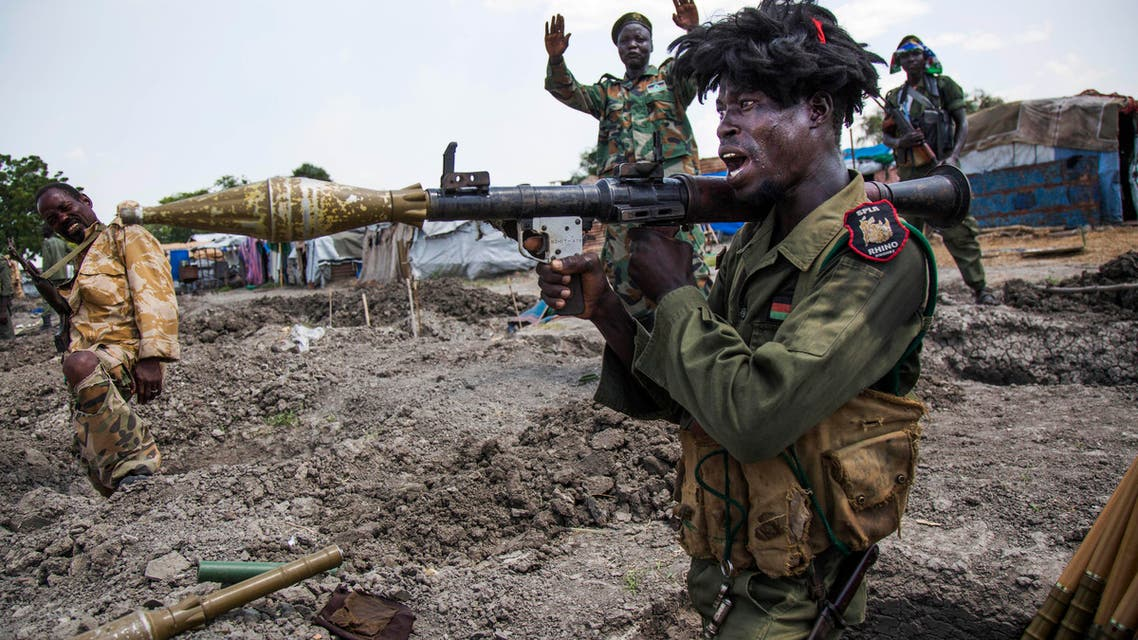 Soldiers of the Sudan People Liberation Army (SPLA) celebrate while standing in trenches in Lelo, outside Malakal, northern South Sudan, on October 16, 2016. (AFP)