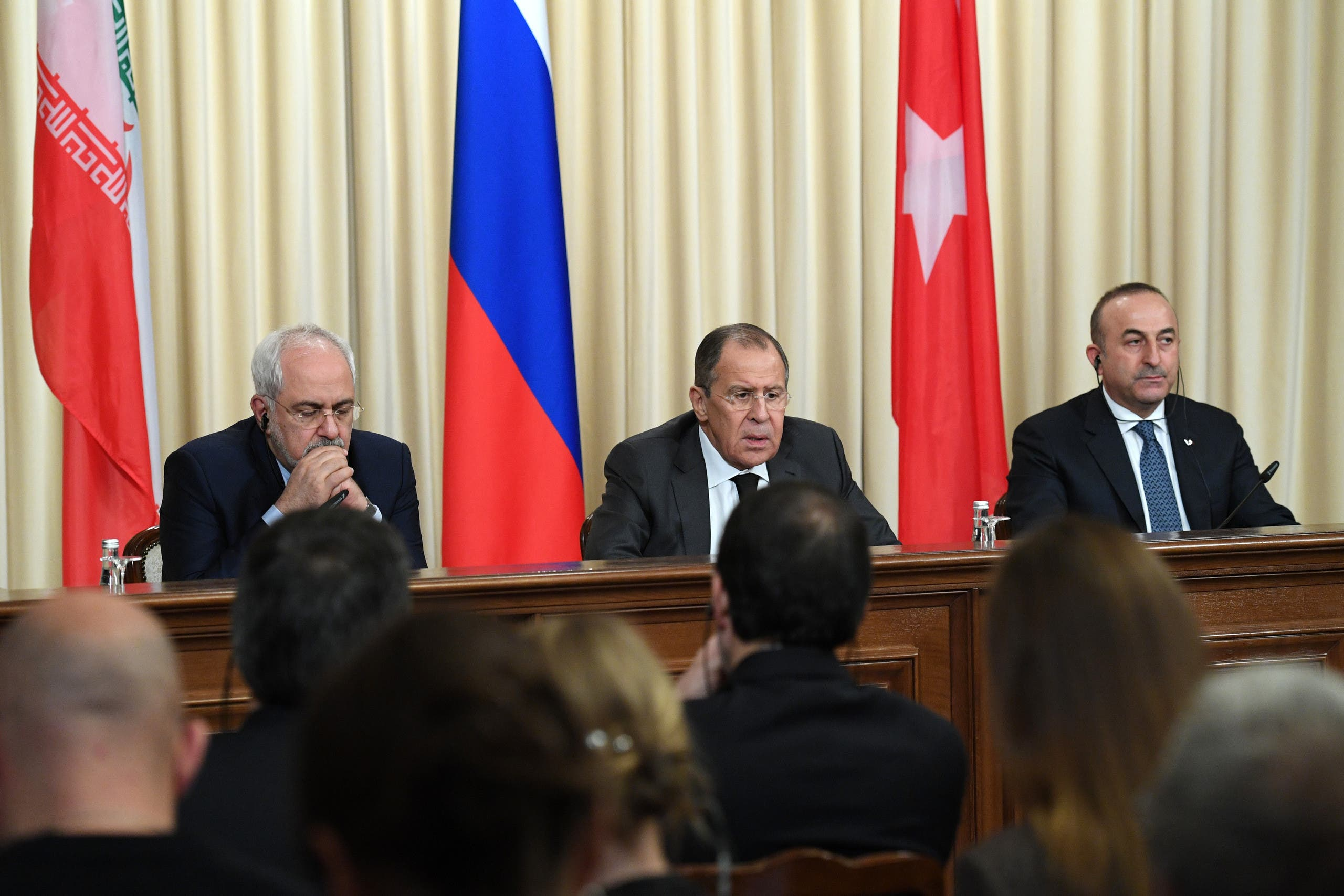 Iranian Foreign Minister Mohammad Javad Zarif, Russian Foreign Minister Sergei Lavrov and Turkish Foreign Minister Mevlut Cavusoglu attend a press conference in Moscow on December 20, 2016. (AFP)