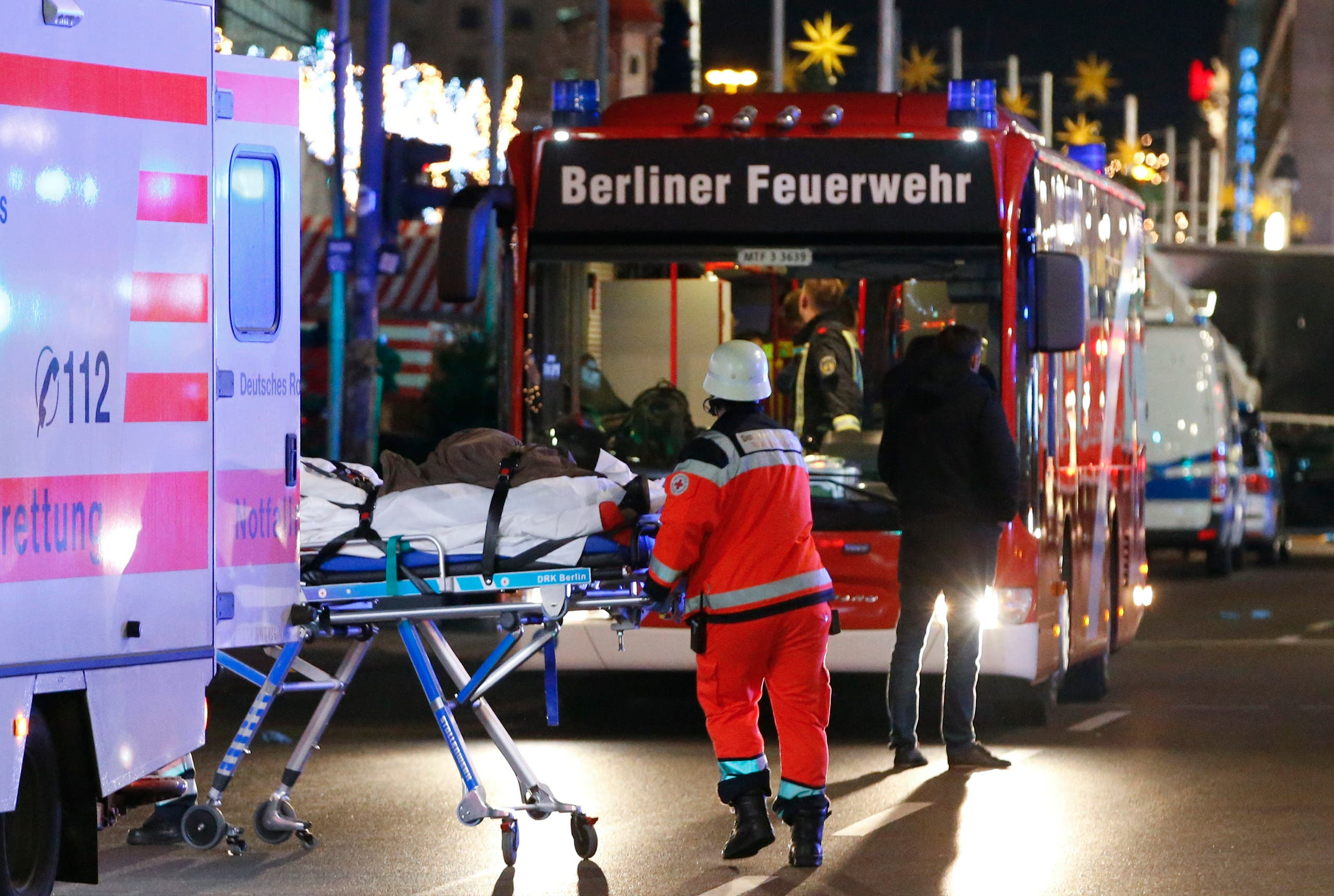 A survivor of an accident with a Polish truck is rescued on a stretcher near a Christmas market on Breitscheidplatz square near the fashionable Kurfuerstendamm avenue in the west of Berlin, Germany, December 19, 2016. (Reuters)