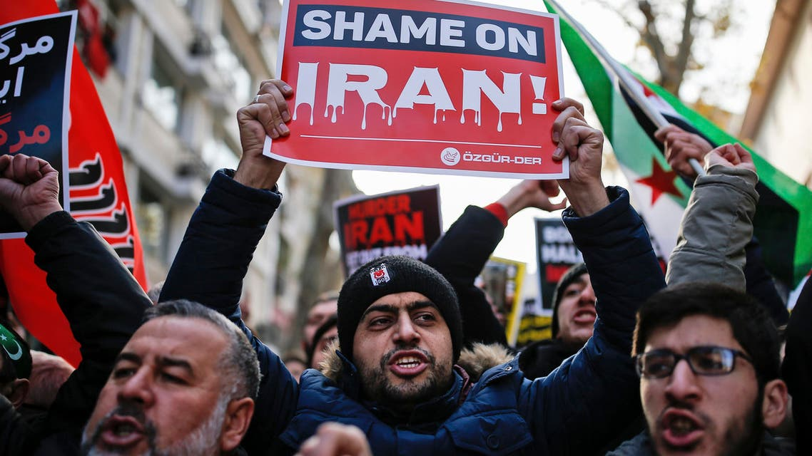 Members of a pro-Islamic group chant slogans and hold anti-Iran placards during a demonstration against the war in Aleppo, Syria, and what they call Iran's involvement in the conflict, close to Iran's consulate in Istanbul, Friday, Dec, 16, 2016. (AP)