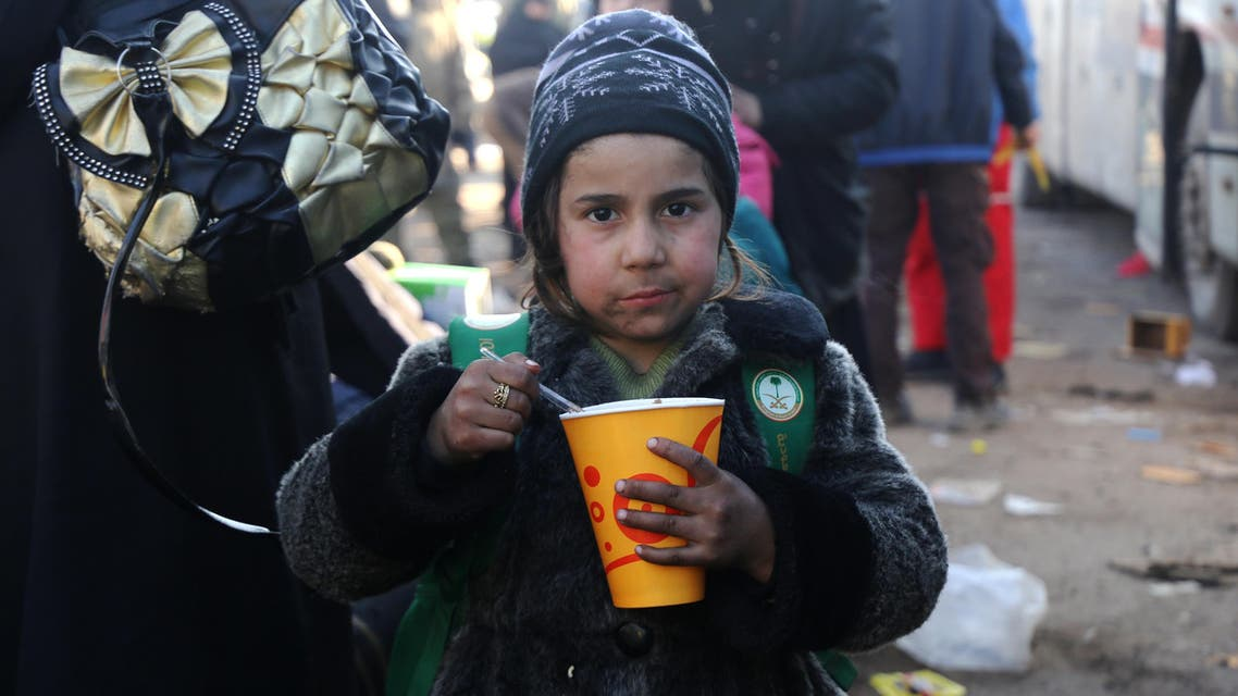A Syrian girl, who was evacuated from the last rebel-held pockets of Syria's northen city of Aleppo, eats upon arriving on December 20, 2016 in the opposition-controlled Khan al-Assal region, west of the embattled city. At least 25,000 people have left the bombed-out eastern districts of Syria's Aleppo since evacuations began last week, the International Committee of the Red Cross said.  Baraa Al-Halabi / AFP
