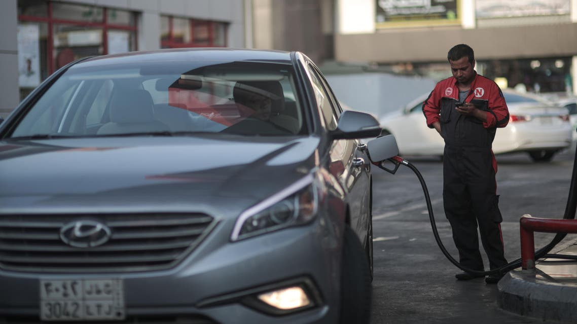 In this Wednesday, Sept. 16, 2015 file photo, a car fills up at a gas station in Jeddah. (AP)