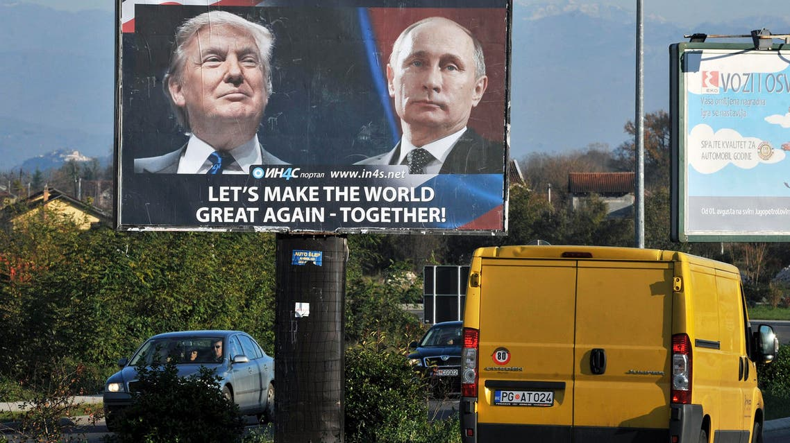 Cars pass by a billboard showing US President-elect Donald Trump and Russian President Vladimir Putin placed by pro-Serbian movement in the town of Danilovgrad on November 16, 2016. (AFP)
