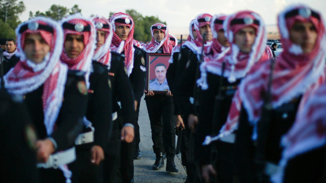 Guard of honor carry a picture of Lieutenant Colonel Saed Mayateh, who was killed during an attack yesterday, during his funeral in the city of Karak, Jordan, December 19, 2016. (Reuters)