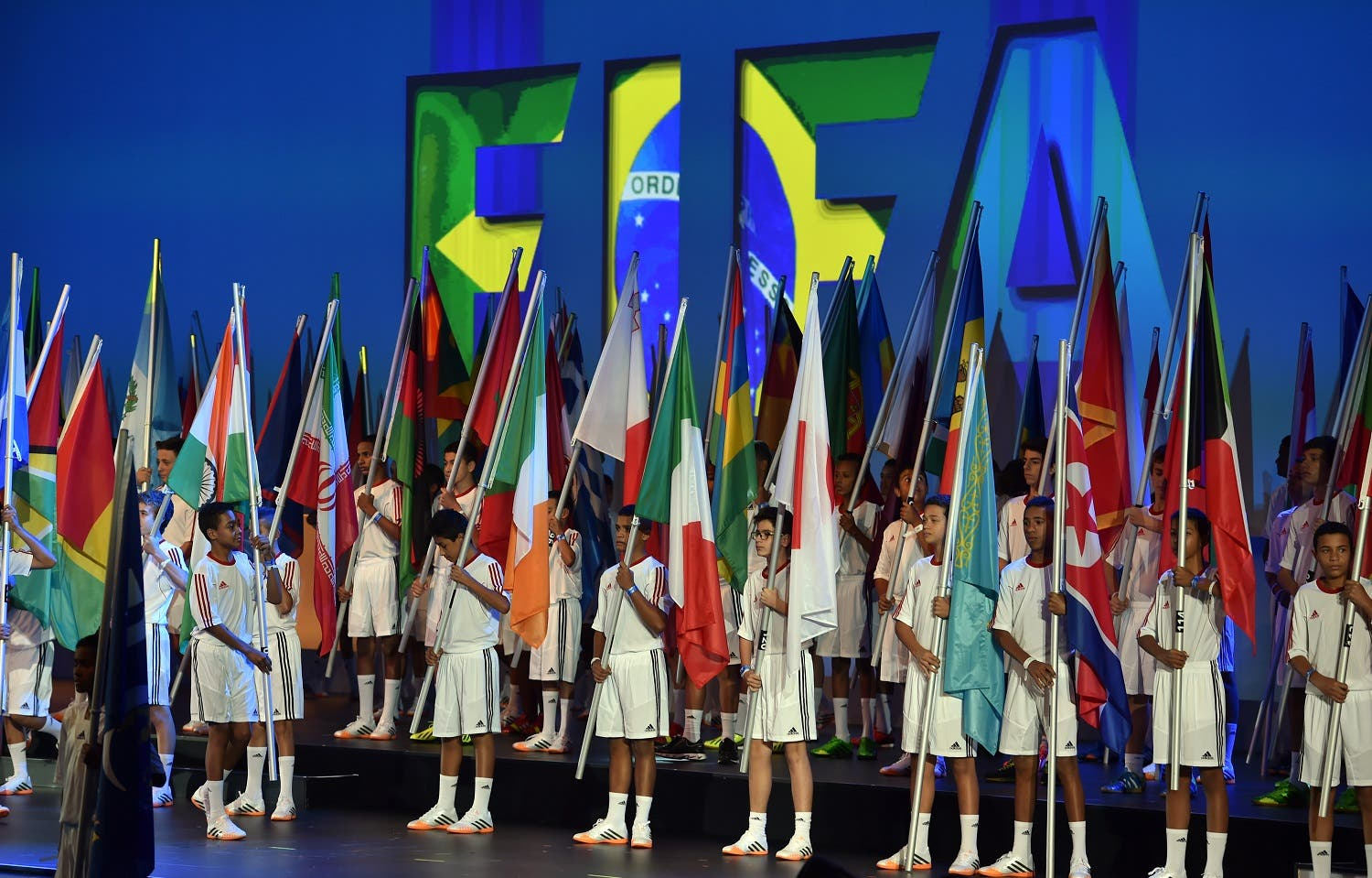 Children hold flags from various countries during opening ceremony of the FIFA Congress in Sao Paulo on June 10, 2014. (AFP)