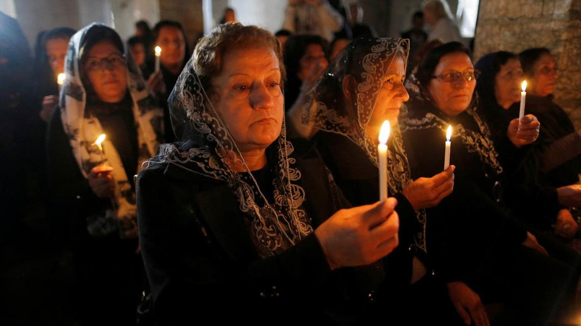 Iraqi Christians attend a mass on Christmas eve at the Mar Shemoni church in the town of Bartella east of Mosul, December 24, 2016. (Reuters)
