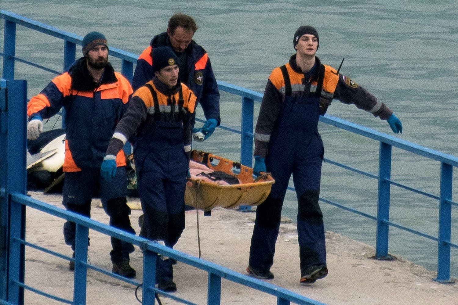 Russian rescuers carry a stretcher with a body recovered after a Russian military plane crashed in the Black Sea. (AFP)