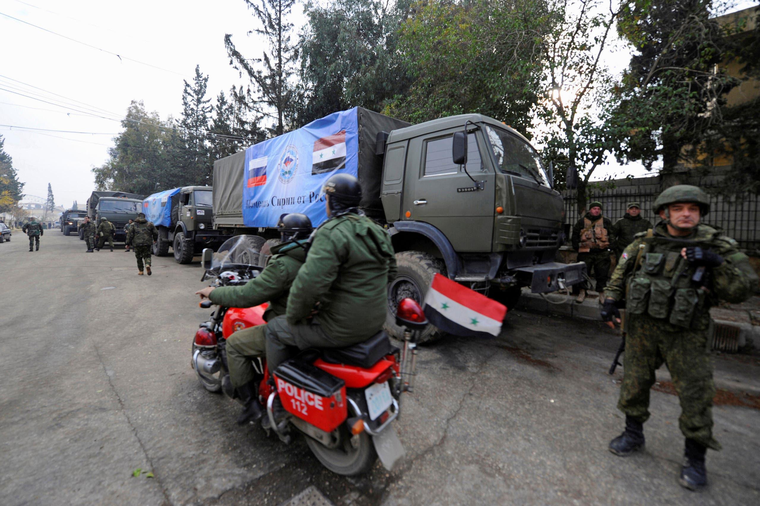 جنود روس ومركباتهم في حلب