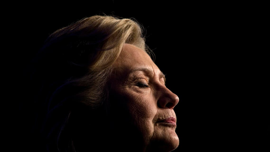 Democratic presidential nominee Hillary Clinton pauses while speaking during a fundraiser at the Capitol Hill Hyatt hotel on October 5, 2016 in Washington, DC. (AFP)