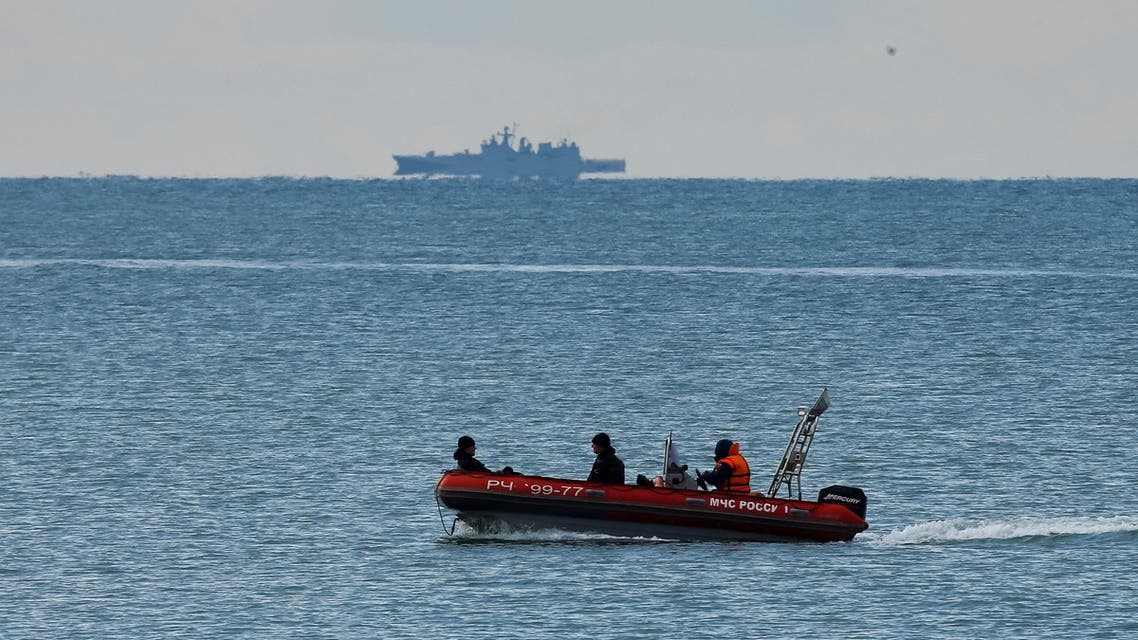 A boat of Russian Emergencies Ministry sails near the crash site of a Russian military Tu-154 plane, which crashed into the Black Sea on its way to Syria on Sunday, in the Black Sea resort city of Sochi, Russia, December 26, 2016