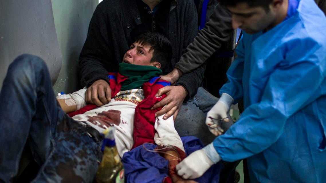 A wounded boy from a district of Mosul, where a suicide attack killed at least 23 civilians, receives treatment at a hospital in Erbil, on December 22, 2016. (AFP)