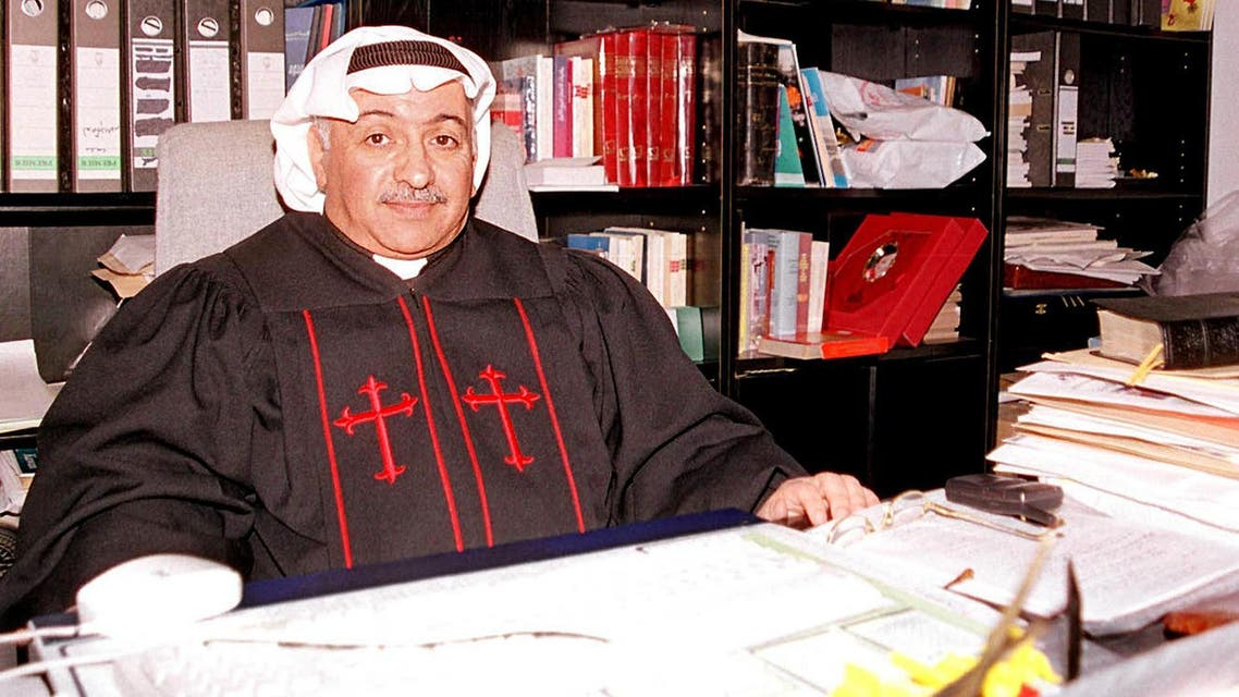 Kuwait's only priest Emanuel Benjamin al-Ghareeb sits in his office at the National Evangelical Church of Kuwait 27 January 2001 in Kuwait City. (AFP)