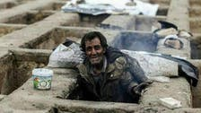 Shocking images emerge of homeless living in Tehran's graves